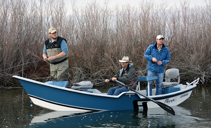 Men Fishing in Drift Boat - boat repair idaho falls