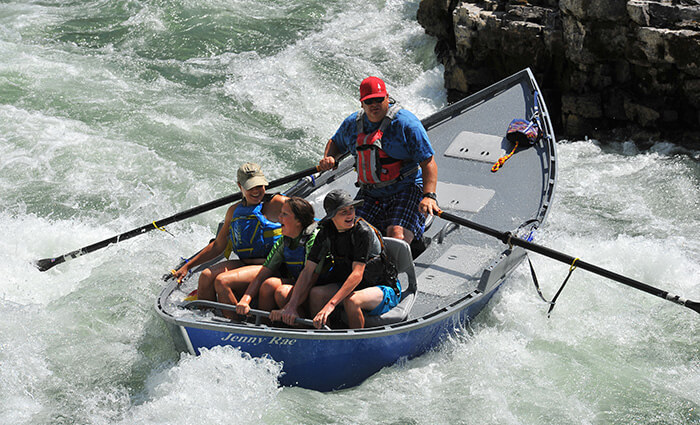 Family Boating On Rapids - boat services idaho falls